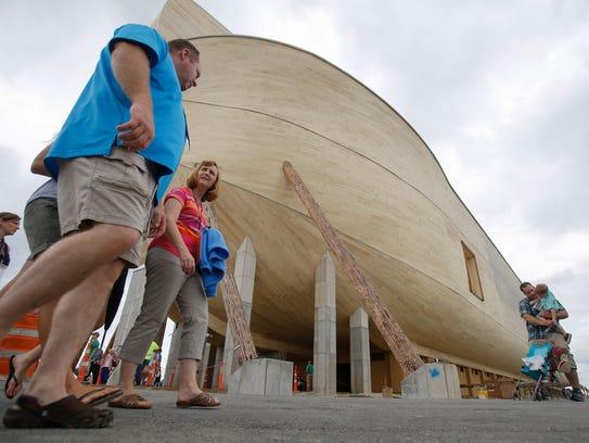 Visitors walk around the 510-foot long, replica ark,