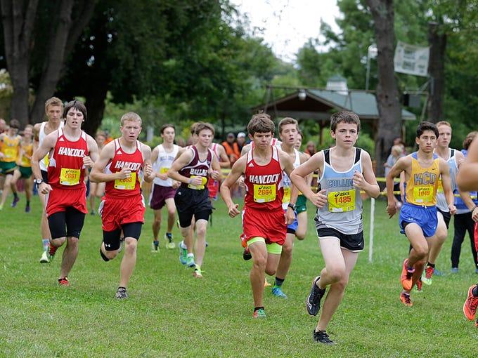 Boys run at the halfway point in the 5K varsity race at at Creasey Mahan Nature Preserve in Goshen. September 13, 2014
