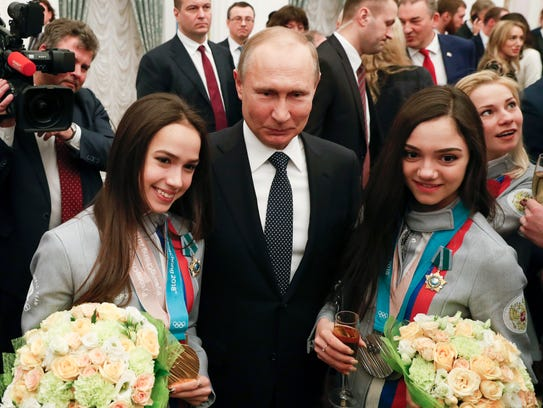 Russian President Vladimir Putin, center, poses for