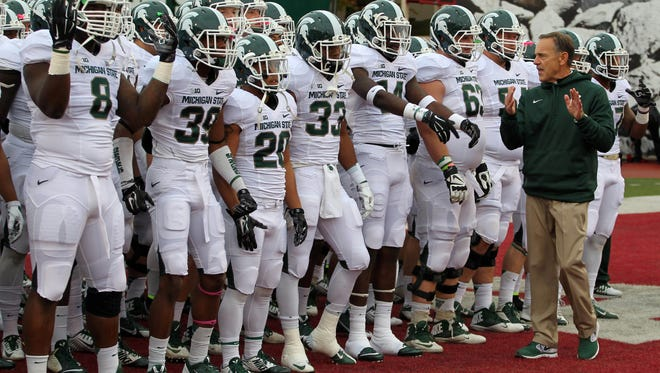 Michigan State Spartans coach Mark Dantonio talks to his team before they take the field against the Indiana Hoosiers at Memorial Stadium.