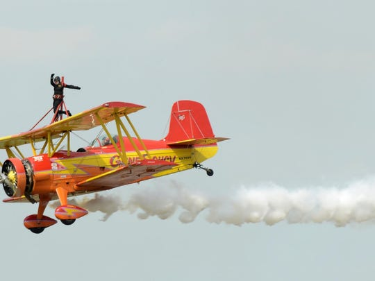 Teresa Stokes stands on top of a plane at the Wings Over Halls air show at the Dyersburg Army Air Base's Arnold Field in this 2014 file photo. This year's air show is set for Saturday Saturday at the Veterans' Museum in Halls.