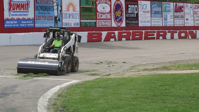 Bill Linn sweeps the Barberton Speedway track Wednesday to prepare for Saturday's reopening.