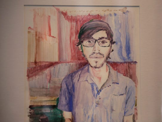 A self portrait by artist Jordan Hartz sits on the