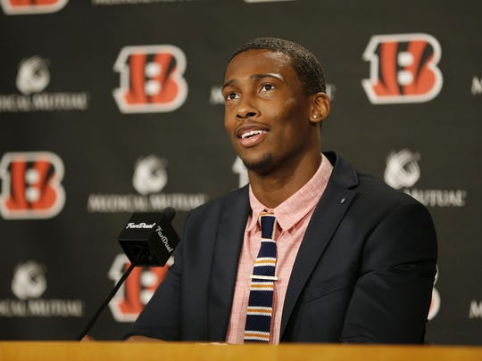 Cincinnati Bengals safety George Iloka talks in a press conference after signing his new contract at Paul Brown Stadium in downtown Cincinnati, on Thursday, March 10, 2016.