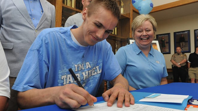 Smoky Mountain alum Jackson Simmons signed to play college basketball for North Carolina in 2011.