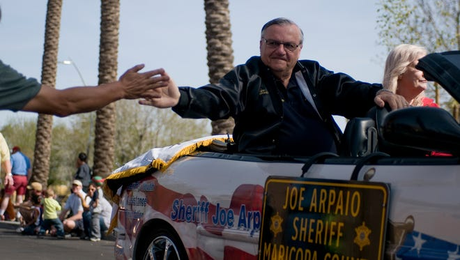 Sheriff Joe Arpaio greeting a fan during a parade