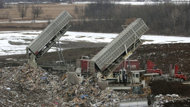 RETRANSMITTING WITH UPDATED CAPTION ** ADVANCE FOR WEEKEND, MARCH 8-9 ** This March 3, 2003 file photo shows garbage from Toronto being dumped at Republic Services Carleton Farms in Sumpter Township, Mich. On Monday, Jan. 17, 2010, Michigan U.S. Sens. Debbie Stabenow and Carl Levin announced that they have received assurances that officials from Ontario will honor an agreement the sides negotiated four years ago to stop shipments of city waste to Michigan as of Dec. 31, 2010. (AP Photo/Paul Sancya)