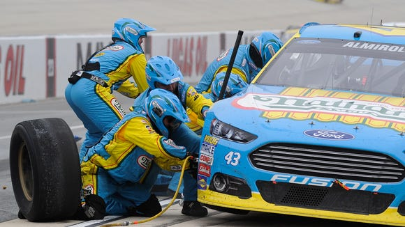 Aric Almirola during a pit stop at the NASCAR Sprint Cup Series AAA 400 at Dover International Speedway in Dover, Del.