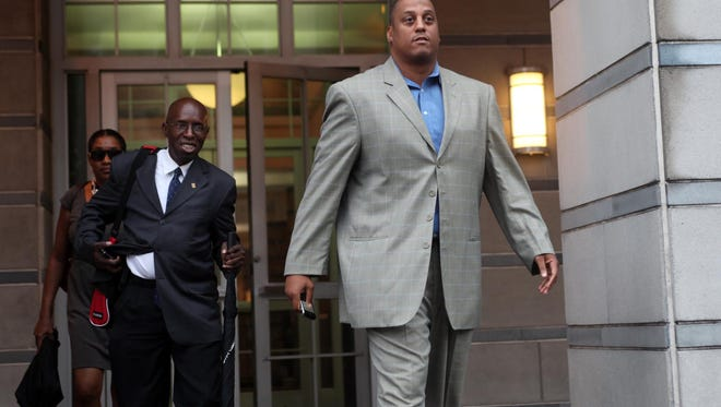 In this Sept. 23, 2011, file photo, former NBA player and University of Connecticut star Tate George leaves federal court in Newark, N.J. Tate George is in federal court in New Jersey for a sentencing hearing on fraud charges connected to an alleged Ponzi scheme. Wednesday's, Jan. 20, 2016, hearing in Trenton is a continuation of hearings that began in December.  (Leslie Barbaro/The Record of Bergen County via AP,  File)