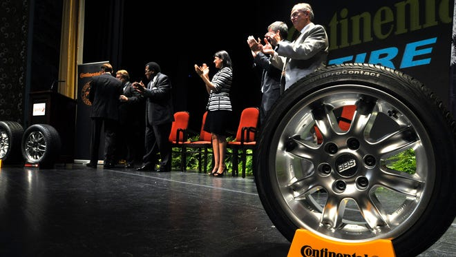 South Carolina state and local officials applaud Continental global tire head Nikolai Setzer, on Oct. 6, 2011, as he announces Continental Tire the Americas LLC will construct the plant in Sumter. South Carolina officials say Mississippi is gaining a good corporate partner with Continental.