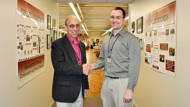 Clair Weaver, left, shakes hands with Ryan Newswanger, who will replace him as CEO of Jubilee Ministries in April. Weaver is retiring after leading the prison ministry for the last 25 years. Newswanger, who lives in Myerstown, has been operations director of Jubilee's five thrift shops since 2014.