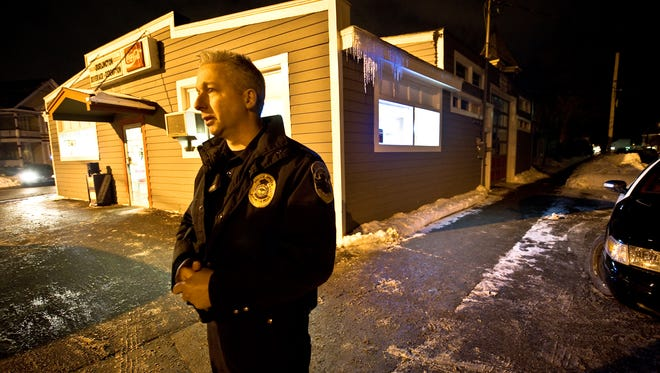 Then-Lt. Bruce Bovat stands in front of the Burlington Beverage Center & Bottle Redemption on the corner of North Union Street and North Winooski Avenue in January 2011. Bovat is leaving the Burlington Police Department on Friday after 21 years of service.