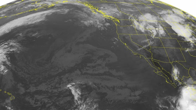This NOAA satellite image taken Monday, Sept. 5, 2016, at 1:00 a.m.M EDT shows an area of low pressure over the Intermountain West. This system is producing widespread rain showers with embedded thunderstorms. The highest elevations of Idaho and Wyoming, and Montana will also see snow showers. High pressure over the Great Basin promotes mostly sunny skies across the desert southwest. Tropical Storm Newton is south of the Baja Peninsula. Norman has maximum winds of 40 miles per hour as it moves northwest at 8 miles per hour.
