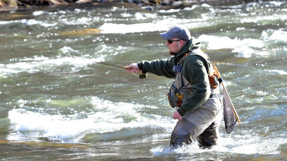 Bob Lux works on hooking a fish during the Fly Fishing Qualifier in this file photo. The WNC Fly Fishing Expo takes place at the WNC Agricultural Center Dec. 2 and 3.