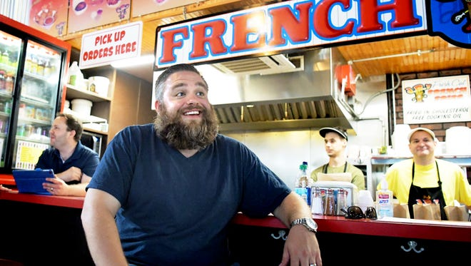 Downtown Inc CEO Silas Chamberlin talks with guests at J.R.'s Fries at Central Market during his quest to eat french fries at 27 different downtown York restaurants on National French Fry Day Friday, July 13, 2018. J.R.'s was the fourth stop on the Fantastic French Fry Frenzy tour. Bill Kalina photo