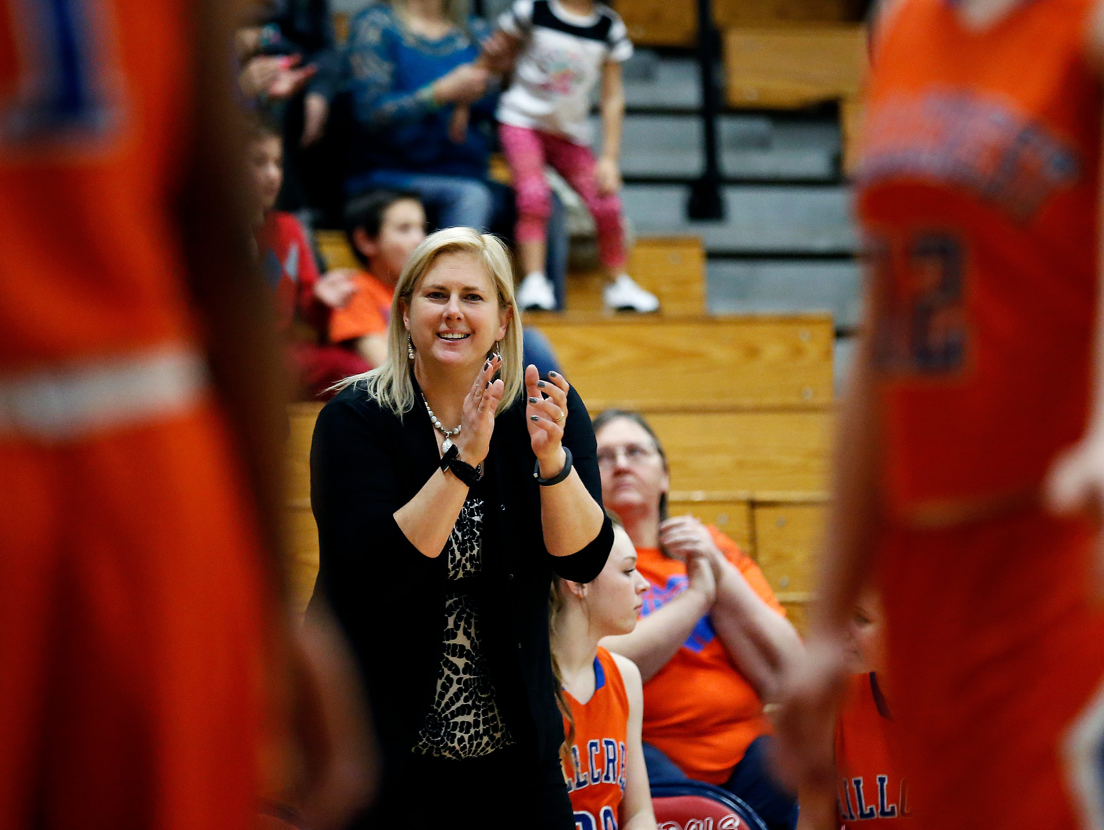 Hillcrest High School head coach Jeni Hopkins reacts during fourth quarter action of the Hornets' game against Glendale High School at Glendale High School in Springfield, Mo. on Jan. 7, 2015. The Hornets won the game 49-39.