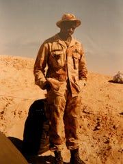 Sgt. Glen Coleman stands near his camp in Saudi Arabia