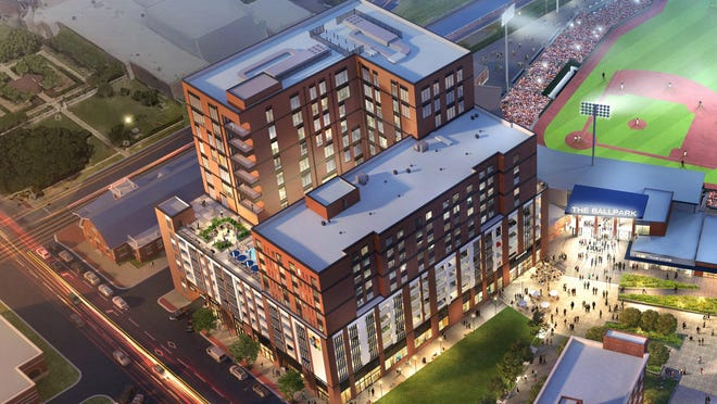 A rendering of downtown Fayetteville redevelopment, including Segra Stadium, the new parking deck on the left of the image with a planned hotel building and office building on top, the rehabilitated Prince Charles apartment building at the bottom, and on the right the previously built Festival Park Plaza office building.