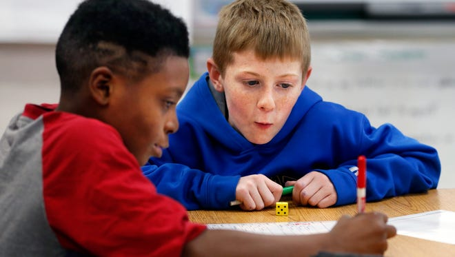 Jakereun Sparks, left, and Nate Cardwell work during the Green Valley Elementary's after-school program.