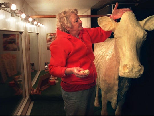 "The late Norma ""Duffy"" Lyon put the finishing touches on her 550-pound butter cow a few days before the Iowa State Fair in 1996. The so-called ""Butter Cow Lady"" sculpted the fair's cow for almost 50 years."