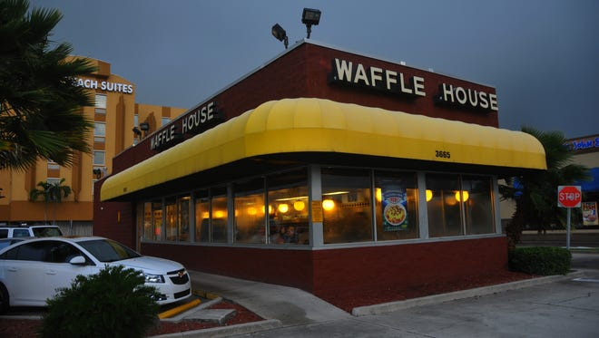 Thursday morning was balmy with mild breeze and high humidity and rain clouds offshore.  While many businesses were closed or boarded up, Waffle House was open for business.