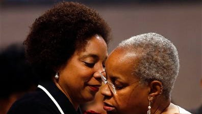 Hasna Muhammad, left, embraces her sister Nora Davis Day during a memorial service for their mother, actress Ruby Dee, at The Riverside Church, Saturday in New York.
