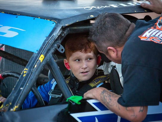 "Eleven-year-old race car driver Aasa ""Boo"" Flores gets"