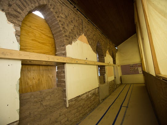 Adobe brick of the west wall is revealed in the interior