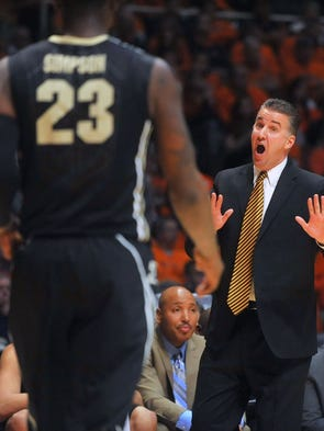 Purdue coach Matt Painter talks to forward Jay Simpson during the first half of an NCAA college basketball game against Illinois on Wednesday, Jan. 15, 2014, in Champaign, Ill. (AP Photo/Rick Danzl)