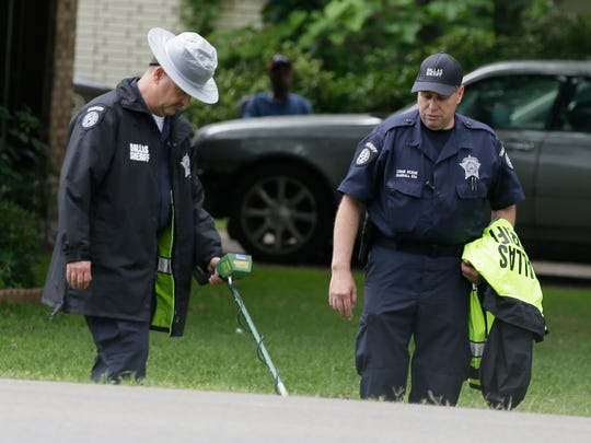 Dallas County Sheriff crime scene investigators use a metal detector at the intersection near where Jordan Edwards was killed by a police officer in Balch Springs, Texas, Wednesday, May 3, 2017. As the family of the black teenager slain by a white police officer calls for an indictment and more investigation, the Dallas suburb where he died faces some of the same issues with race as Ferguson, Cleveland, and other cities that have experienced high-profile police shootings of African-Americans. (AP Photo/LM Otero)