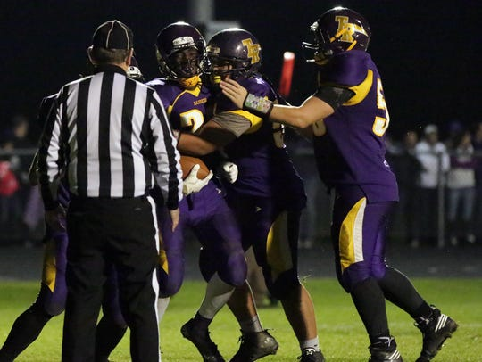 Two Rivers players surround Darrin President (23) following