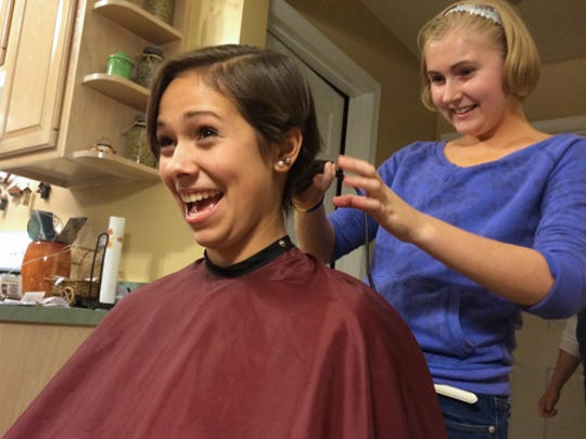 Maddie Hill shaves off Emily Spaulding's hair Monday