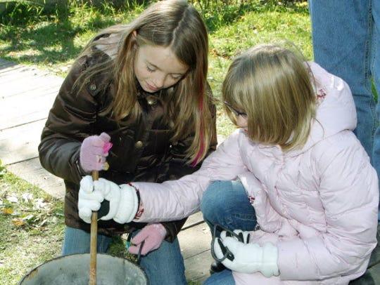 STIRRING SOAP - Eirene Kulutbanis (left), 10, and Jessica