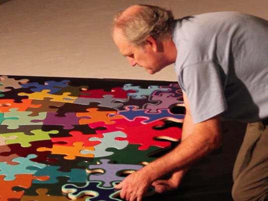 Muncie-Artist-Kevin-Campbell-working-on-his-Puzzle-Project.jpg
