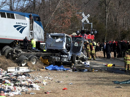 Emergency personnel work at the scene of a train crash involving a garbage truck in Crozet, Va. Jan. 31, 2018. The Amtrak passenger train carrying dozens of GOP lawmakers to a Republican retreat in West Virginia struck a garbage truck south of Charlottesville, Va.