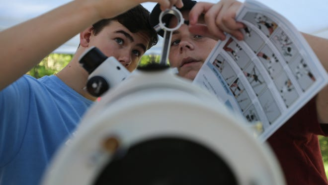 Seacrest Country Day School students Alexandre Chapelle, left, 15, and Thomas Richardson, 15, set up a telescope Saturday, Aug. 19, 2017, in Blue Ridge, Ga. A small group of students and staff from Seacrest made the trek to Georgia to witness the solar eclipse from the path of totality.