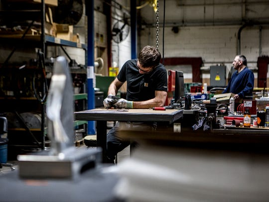 Grant Guthrie works the production line at Jones Metal
