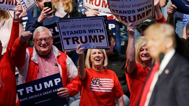 Supporters cheers as Republican presidential candidate Donald Trump speaks during a campaign stop at the Allen County War Memorial Coliseum, Sunday, May 1, 2016, in Fort Wayne, Ind.