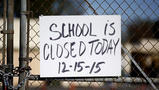 A gate to Birmingham Community Charter High School is locked with a sign stating that school is closed, Tuesday in Van Nuys, Calif. All schools in the vast Los Angeles Unified School District, the nation's second largest, have been ordered closed due to an electronic threat Tuesday.
