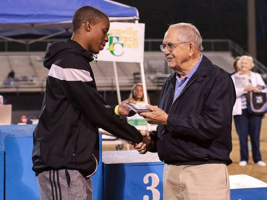 Jim Mattos, right, presents the award for Greenville County boys running events MVP, named after Mattos, to Greer's Troy Pride following last week's county meet. Mattos, former coach and athletic director at Berea, will be inducted into the SCACA Hall of Fame in July.