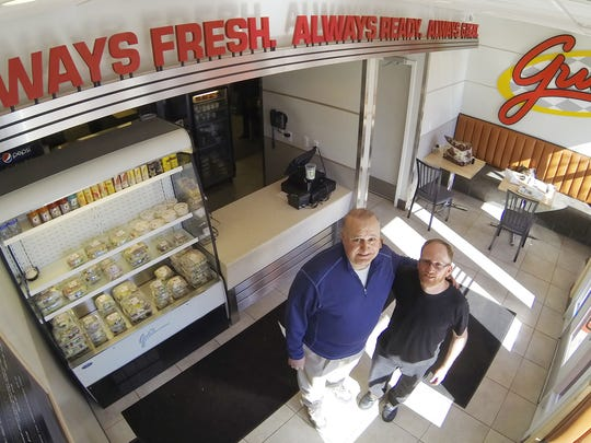 Gus's Carry Out owner Ilia Nicholas, left, and district