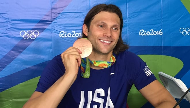 Cody Miller shows off his Olympic bronze medal.