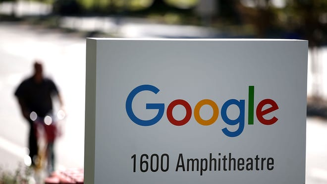 The new Google logo is displayed on a sign outside of the Google headquarters in Sept.