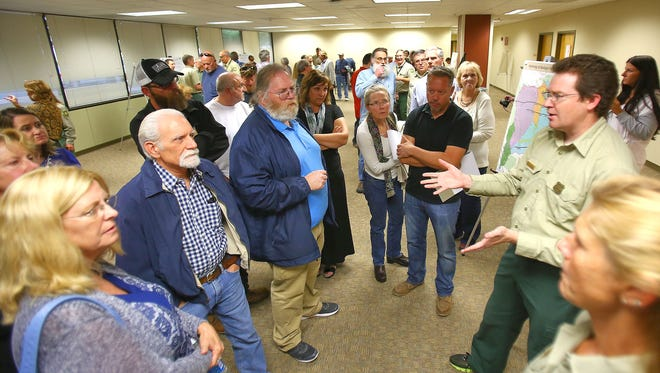 Robert Taylor, a hydrologist with the U.S. Forest Service, talks with the public about a proposal to renew a permit that enables Nestle to pipe water out of the San Bernardino National Forest for bottling.