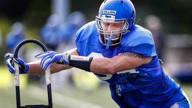 University of Memphis linebacker Jackson Dillon drills with a tackling sled during a recent practice.