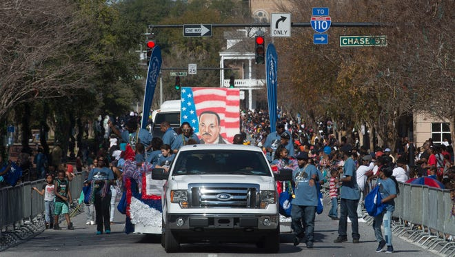 Civic organizations, businesses and private citizens march along the parade route to honor and celebrate the memory of Martin Luther King, Jr. in downtown Pensacola during a past parade. This year's celebration takes place Monday.