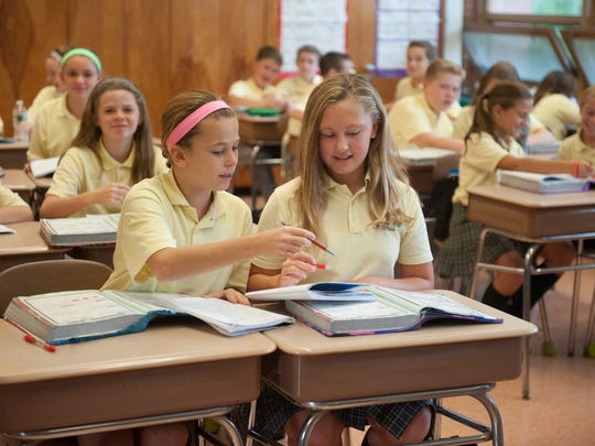 6th-graders Carly Serlenga (left) and Grace Kueny work together during advanced math class at Our Lady of Good Counsel School in Moorestown. This private school was one of only two in South Jersey which recently earned a National Blue Ribbon School distinction from the U.S. Department of Education. Friday, October 9, 2015.