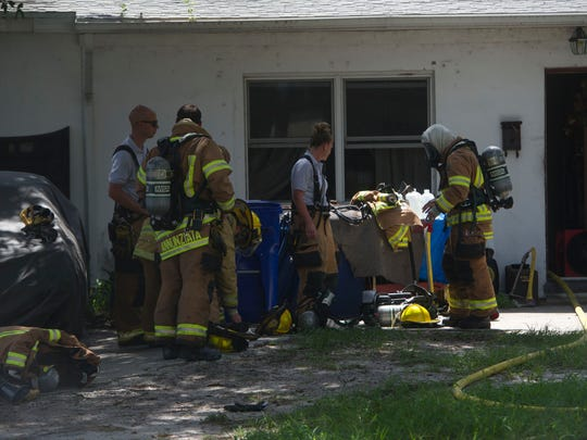 "Indian River County Fire Rescue and the Vero Beach Police Department helped rescue Nikki Alascil's Pomeranian, Mary, from a house fire June 23, 2017 in Vero Beach. Another dog, Flipper, was later discovered in the neighborhood. Alascil wasn't home when the electrical fire started, but neighbors Darian Crowe and Cannon Screus responded to the fire by throwing water at it. ""That probably saved Mary's life,"" Alascil said."