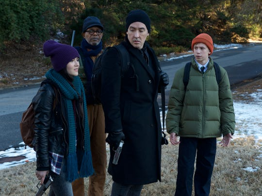 "Isabelle Fuhrman, from left, Samuel L. Jackson, John Cusack and Owen Teague swear off smartphone use and try to survive in ""Cell."""