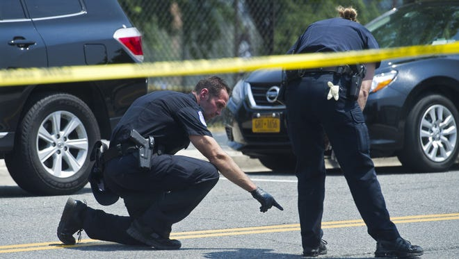 Crime scene investigators search for evidence at the scene of the shooting in Alexandria, Va., on June 14, 2017, where House Majority Whip Steve Scalise and others were shot during a congressional baseball practice.